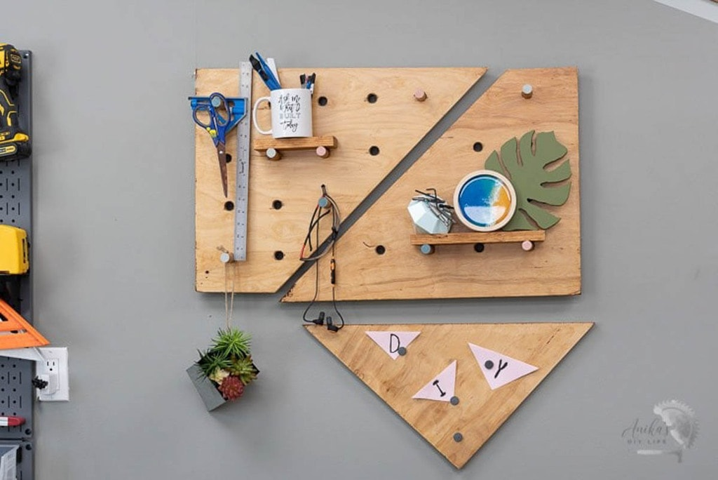 Pegboard made from scrap wood in three geometric sections