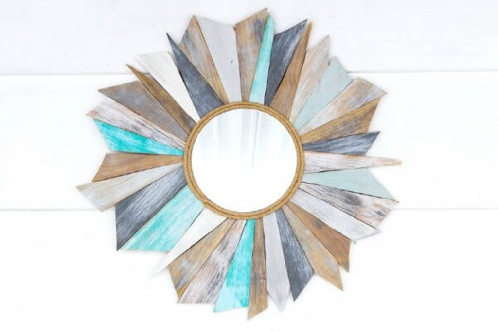 sunburst mirror made from scrap plywood with a weathered beachy finish