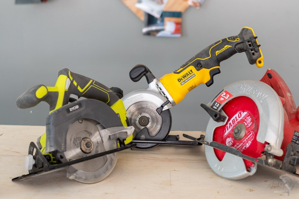three types of circular saws on a workbench