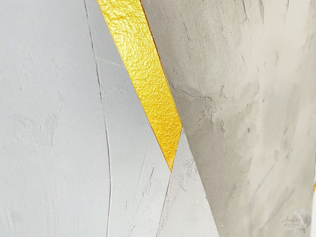 Close up of the gold and gray DIY cement feature wall