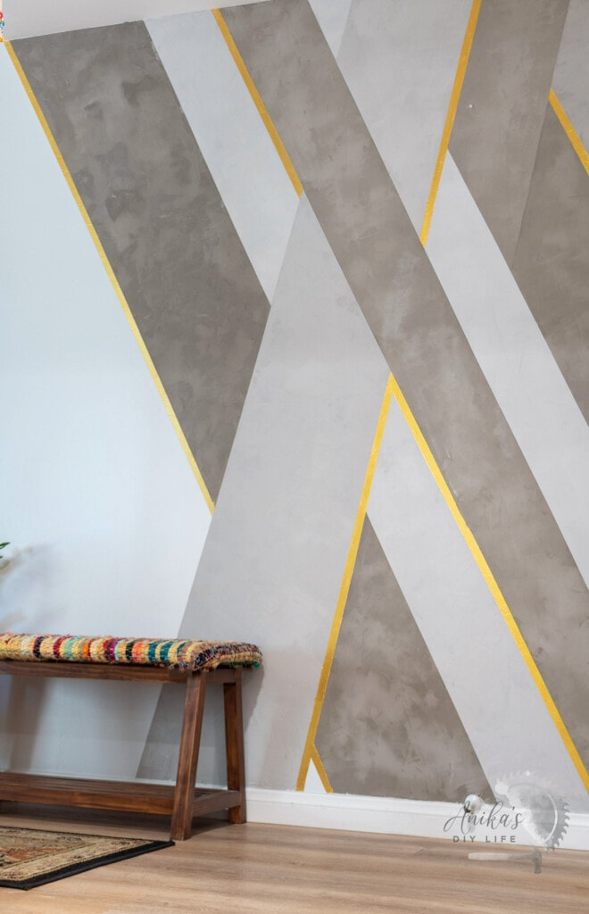 Full DIY concrete accent wall in an entryway