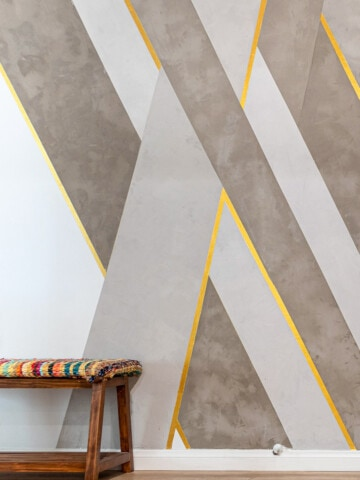 This DIY cement feature wall is going to blow you away! Learn how to make the coolest concrete accent wall with the complete source list, tutorial, and video!