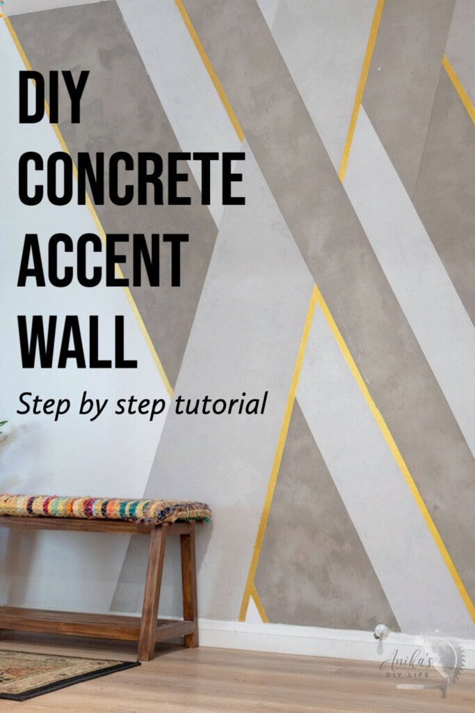 DIY Cement accent wall with gold accents in an entryway