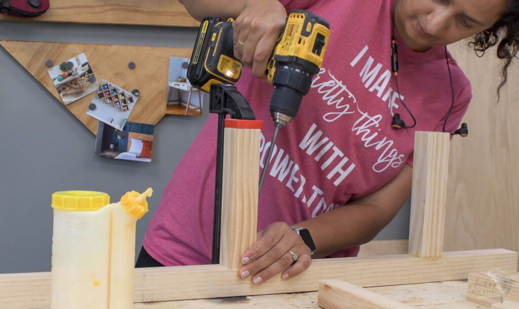 woman attaching boards using pocket hole screws