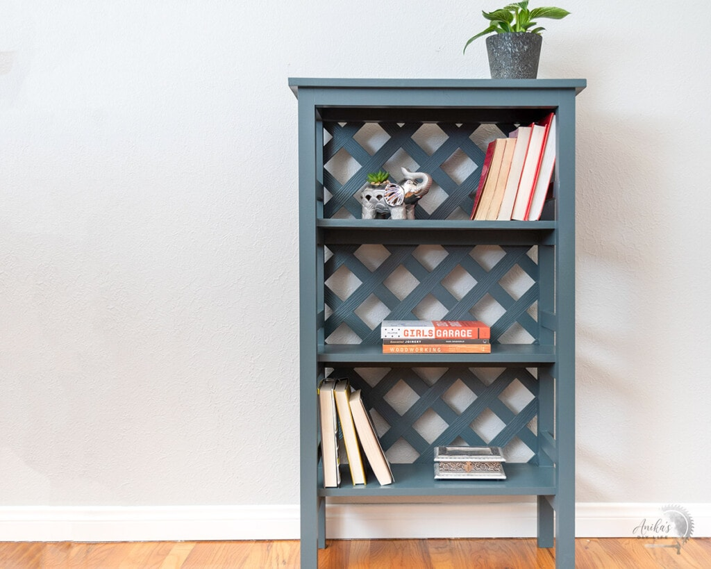 bookshelf built with trellis back with books and plants