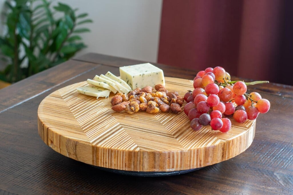 Chevron patterned plywood lazy susan on table
