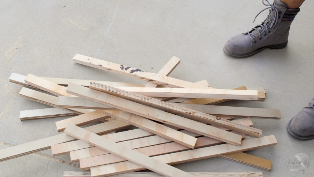 stack of plywood strips to be assembled into patterned plywood