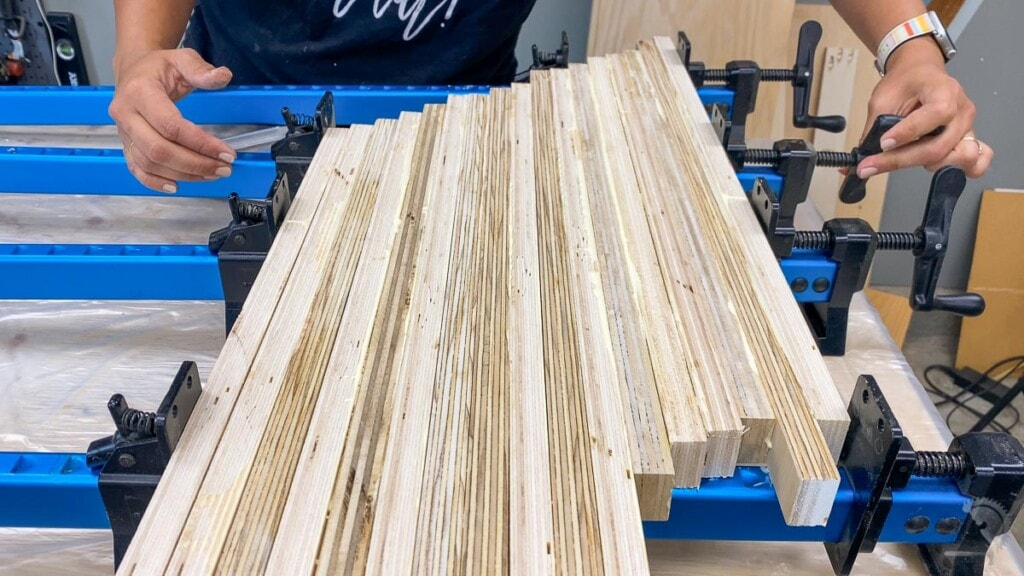 glueing up plywood strips with 45-degree stagger to make patterned plywood