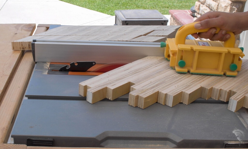 Cutting out strips of the patterned plywood to make the chevron patterned plywood