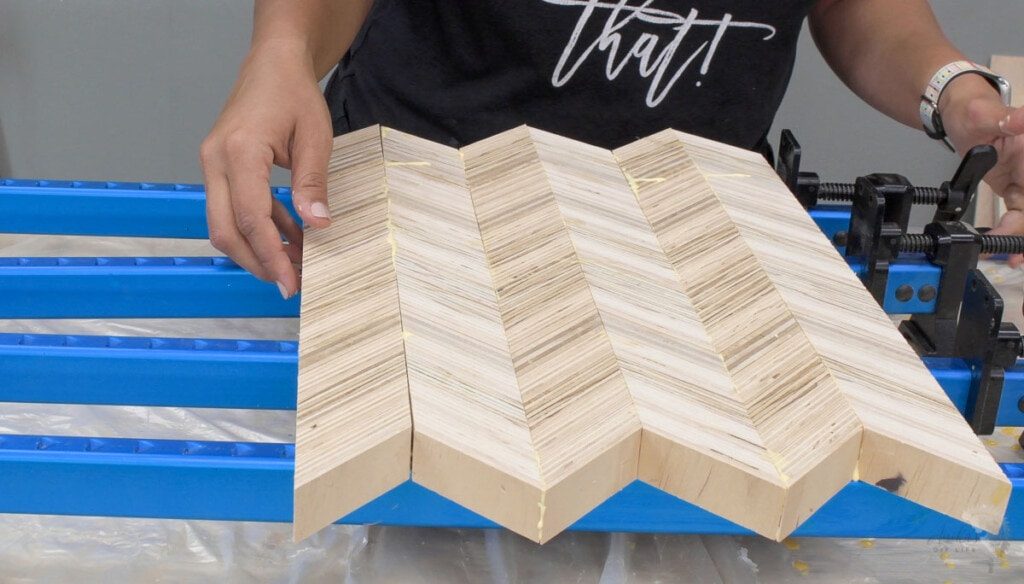 Gluing up patterned plywood to make chevron plywood