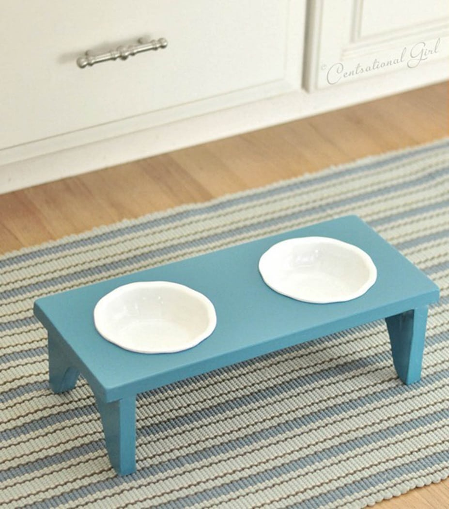 blue dog bowl stand with white bowls