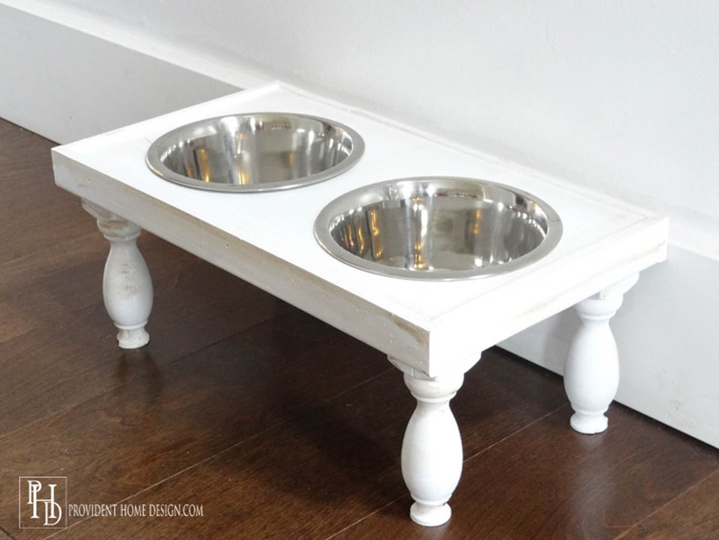 white dog bowl stand with turned legs