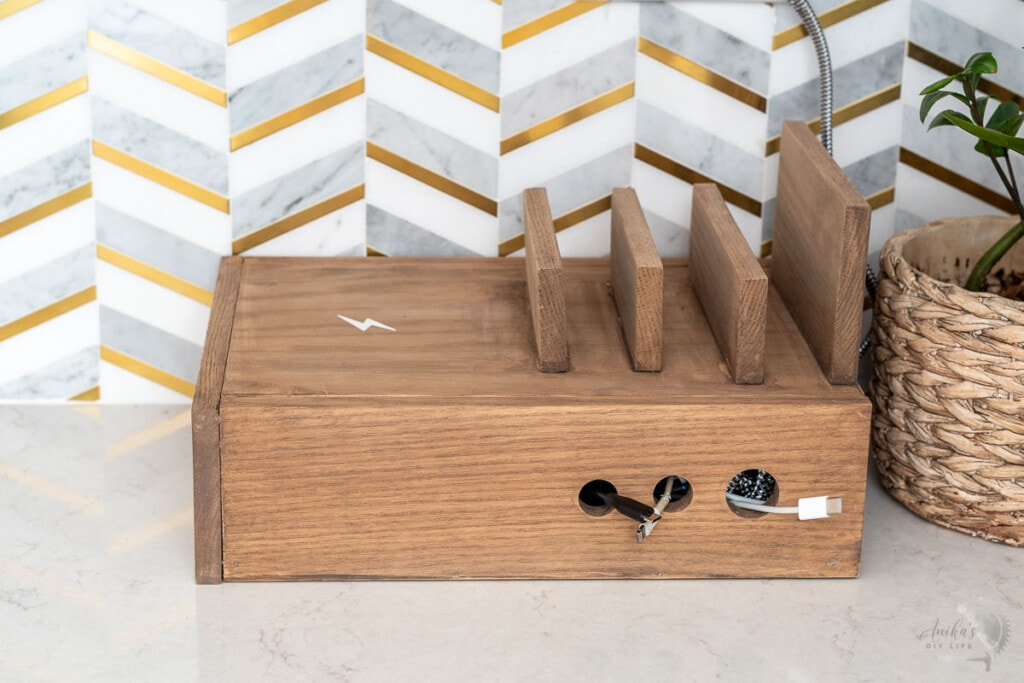 wooden device charging station on kitchen counter
