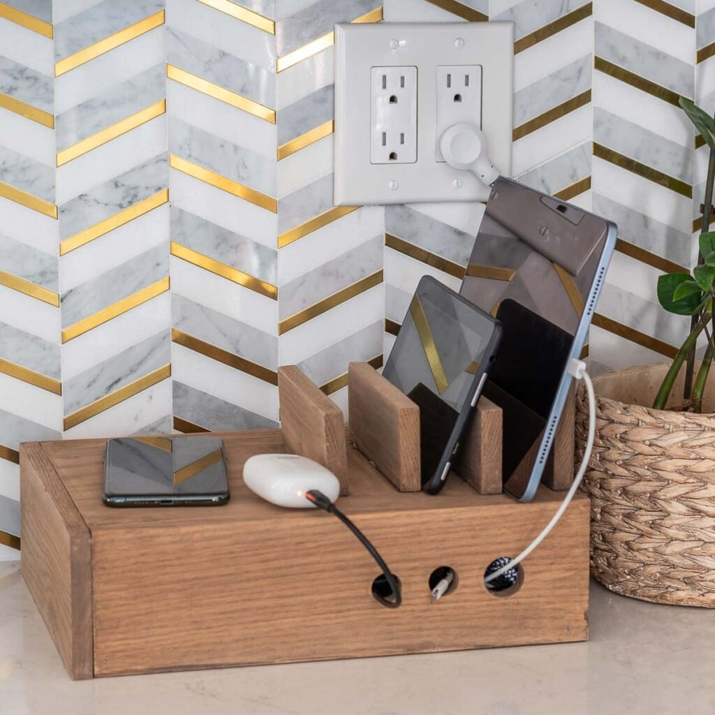Build a simple DIY device charging station to get the wire clutter under control with a family charging station including a built-in wireless charger.