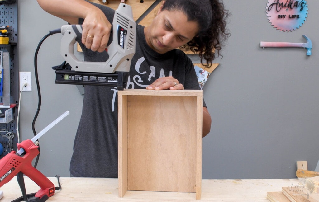Woman building the box for the DIY device charging station