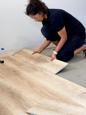 Anika installing vinyl plank flooring