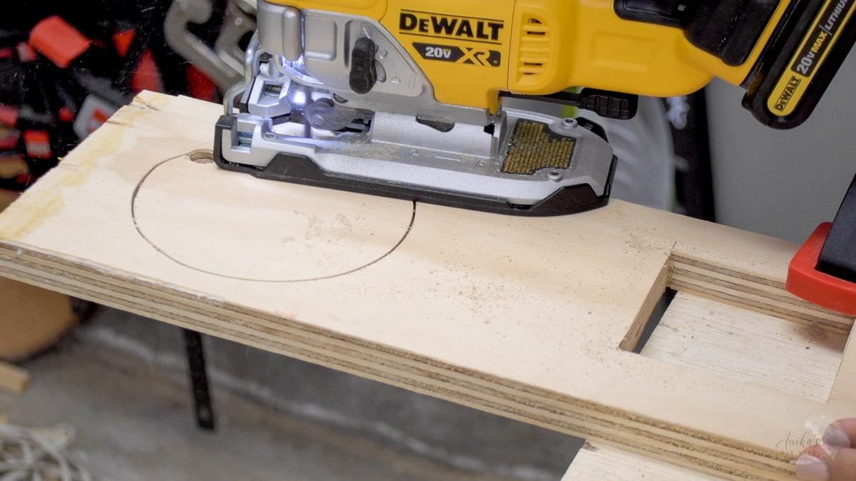 cutting a hole in a board with a jigsaw